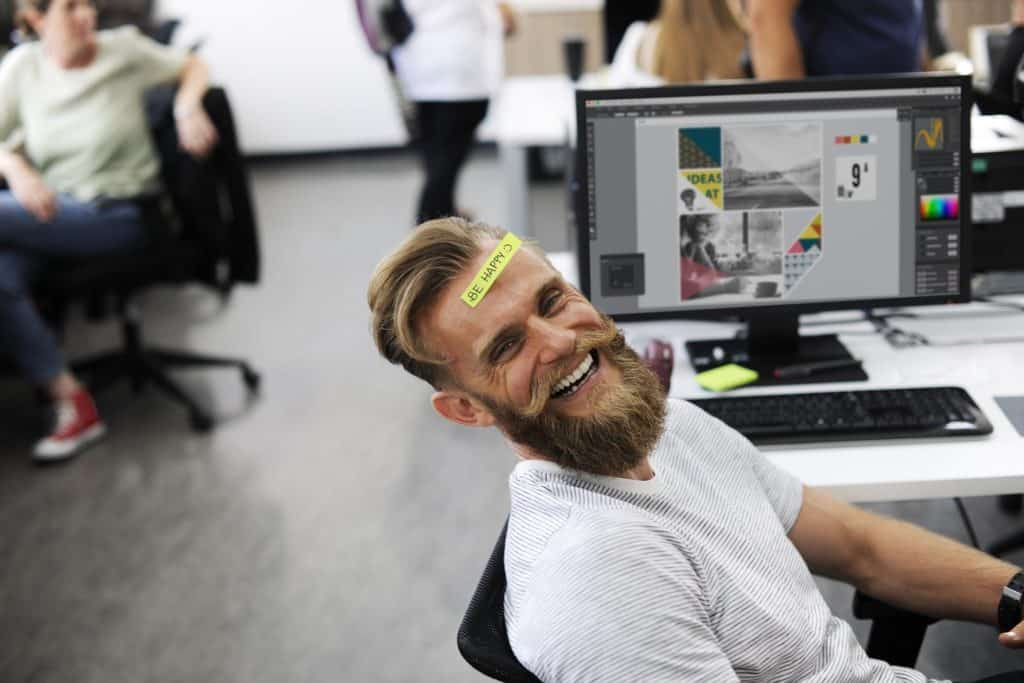 Happy hipster at work